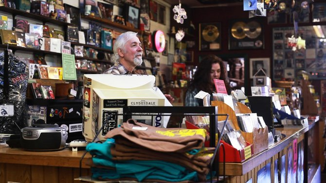 Tim and Lisa Cretsinger, Groovacious owners, celebrate Record Store Day at their shop.