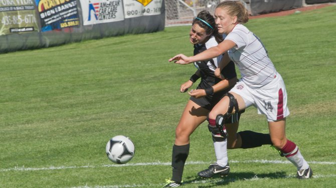 SUU forward Sabrina Hernandez battles for position with Montana defender Alyssa Nystrom during Thursday's 4-4 tie with the Grizzlies at Thunderbird Soccer Field. The T-Birds led 4-1 at halftime, but Montana came back to tie SUU 4-4.