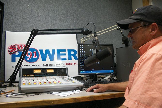 Christopher Holmes, a master of communication student from Cedar City, prepares to record a piece in the Power 91 radio station. Holmes won five awards at the Utah Broadcaster's Association UBEE Awards dinner on Sept. 29.