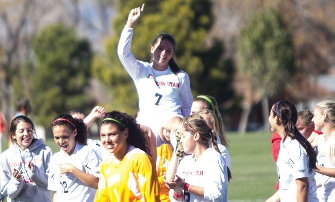 Members of the SUU soccer team carry forward Stacey Brinkman off the field after Brinkman nets the game-winning goal in double overtime to lead SUU to a 3-2 victory over Cal State-Bakersfield Sunday on Senior Day. Brinkman became SUU's all-time goal scorer in school history with the goal.
