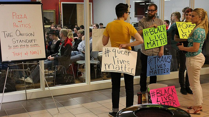 Members of the Real Peers and the Pride and Equality Club, were distressed by some of the comments made at a previous Pizza and Politics so they staged a peaceful protest outside the Levitt Center to make those feelings known.