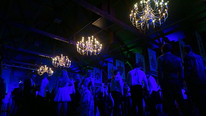 Students dawned for the masquerade held Saturday night in the Hunter Conference Center Great Room. The room was lit by only the lights from the stage and the chandeliers overhead, the atmosphere was one of mystery and darkness.