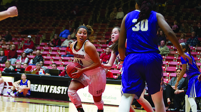 Sophomore guard Breanu Reid (14) slips past the Grand Canyon players during the Dec. 16 game in the Centrum